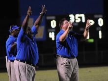 East Wake coaches signal to their players from the sidelines.