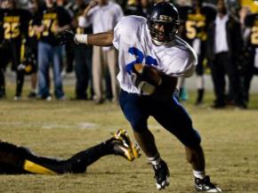 Hillside's Desmond Scott carries the ball for the Hornets against Chapel Hill.