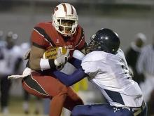 Hillside's Treshaun Council, right, pulls down Southern's Tony Creecy during the NCHSAA playoffs Friday, November 21, 2008 at Durham County Memorial Stadium in Durham, NC. Hillside won 7-0.(Jeffrey A. Camarati/WRAL.com)