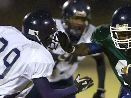 Southeast Raleigh's Dominique Jackson, right, tries to stiffarm Hillside's Chris Jones in the NCHSAA playoffs Friday, November 28, 2008 in Raleigh, NC. Hillside won 30-12.(Jeffrey A. Camarati/WRAL.com)