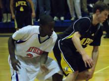 Athens Drive's Quentin Edmundson (24) steals the ball from Apex guard Adam Perry (5)