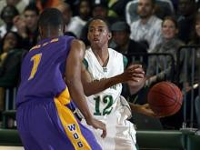 Word of God's Joshua Summerfield, (1) guards Ravenscroft's Madison Jones, (12) on Wednesday night, February 4, 2009 at Ravenscroft High School in Raleigh. Word of God won 82-64. (Photo by C.F.Ward)