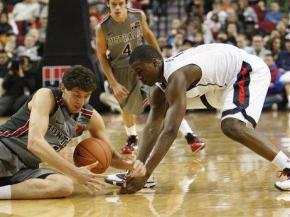Junior National Select Team's Harrison Barnes, right, battles with the World Select Team's Nikola Mirotic, of Montenegro, in the first half during the Nike Hoop Summit Saturday, April 10, 2010, in in Portland, Ore. (AP Photo/Rick Bowmer)