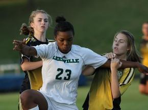Leesville's Faren Frizzelle fends off Broughton's double team action during a big match up on April 12.  Leesville came out on top 4-1. (Photo by Teri Saylor, VYPE High School Sports Magazine/VYPE.com)