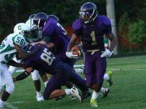 #1 Justin Burris breaks free during Cary High School's 53-26 victory against Broughton High School in the 2010-11 season opener on Friday, Aug. 20. (photo by Will Okun)