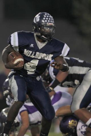 Millbrook's Keith Marshall finds some running room as Broughton wins big 52-26 over Millbrook Friday Sept.24, 2010 at Millbrook high school in Raleigh, NC.