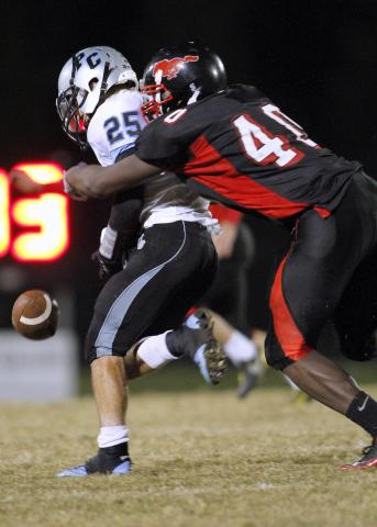 Middle Creek's #40 Josh Banks causes Panther Creek's Greg Garneau to fumble the ball as Middle Creek defeats Panther Creek 42-21.