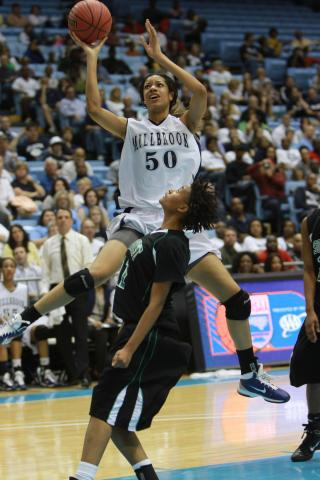 #50 Briana Day scored 4 points and grabbed 7 rebounds in Millbrook High School's 35-44 loss to Southwest Guilford High School in the NCHSAA Class AAAA Women's Basketball Championship on Saturday, March 12. (photo by Will Okun)