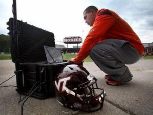 FILE - In this Oct. 5, 2010, file photo, John Shifflett, a Virginia Tech Athletic Trainer and helmet impact field data recorder, sets up the HITS System next to the Virginia Tech football team practice on campus in Blacksburg, Virginia. In the study released in mid May 2011, the university researchers, looking at the effectiveness of helmets in reducing concussions, gave the Riddell Revolution Speed the only five-star rating. But the study was limited to helmets for high school and up, and it also gave Riddell's VSR-4 helmet, which was worn by nearly 40 percent of NFL players last year, its second-lowest rating. Riddell stopped selling the VSR-4 last year. (AP Photo/The Roanoke Times, Matt Gentry)