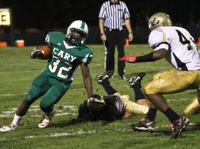 Cary's  Deandre Henry (#32) runs around the end as Cary defeats Lee County 47-14 Friday night September 30, 2011 in Cary, NC.