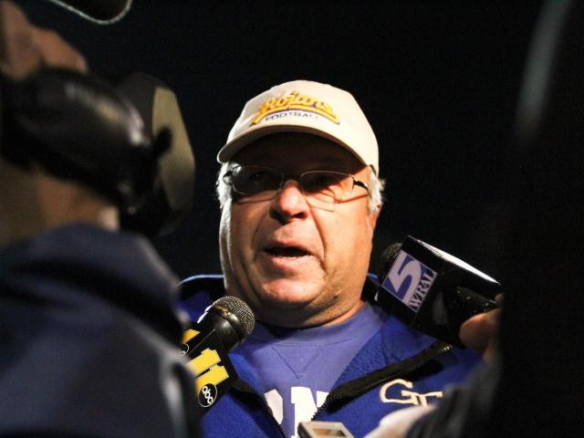 Garner head coach Nelson Smith speaks with reporters after Garner defeated Jack Britt 34 to 27 Friday night November 25, 2011 to advance to the NCHSAA State Championship game.<br/>Photographer: Jack Tarr