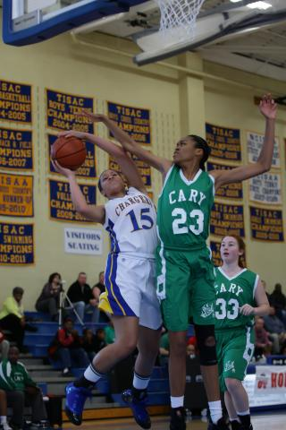 Cary Academy's  Mickayla Sanders has her shot blocked by Cary's  Azura Stevens (#23) as Cary Academy defeats Cary Girls 65 to 39 during the 2012 HSOT.com Holiday Invitational Basketball tournament Monday December 26, 2011.