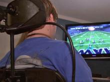 Colt Brake plays video games with a controller he  operates with his mouth.