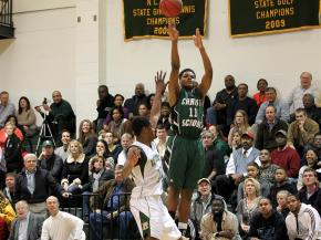 Christ Church's Josh Level #11 take a jumper from outside as Ravenscroft defeats Christ Church 83 to 73 Friday night February 10, 2012. (photo by Jack Tarr)