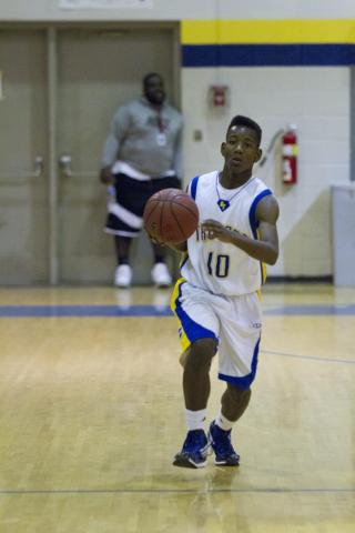 Garner's #10 Julius Barnes dripples down the court in their Monday night victory against Harnett Central, winning 79-53 (photo by Wes Hight).