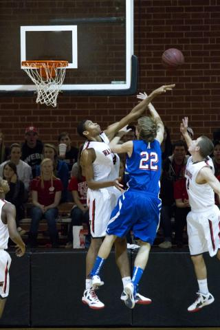 #4 Isaiah Hicks blocks an Asheboro player Tuesday night in Webb's victory, winning 72-56 (photo by Wes Hight).