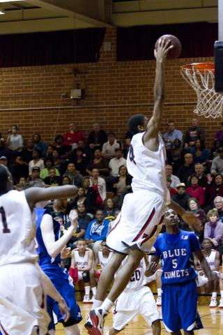 Webb's #4 Isaiah Hicks takes a dunk over Asheboro players Tuesday night (photo by Wes Hight).