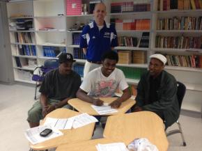 Robert Story of Durham School of the Arts signs with Davidson Community College to play basketball