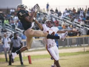 E. E. Smith's Ismail Williamson (cq) (left) catches the ball for a touchdown in the first quarter as Douglas Byrd's Jose Sanchez (right) tries to block during the game on Friday, September 7, 2012.