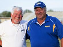 Clayton head coach Gary Fowler and Garner head coach Nelson Smith before the start of tonights game. Garner runs over Clayton 28 to 0 Friday night September 14, 2012.