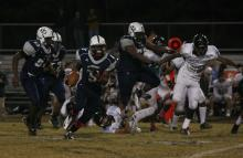 Dontae Thomas-Williams (5) rushes during the East Chapel Hill vs. Hillside game on October 19, 2012 in Durham, North Carolina.