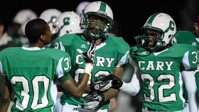 Trevor Ellis (92) celebrates on the sidelines after an interception.  Cary wins at home against Athens 9 to 7.