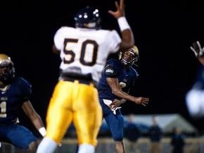 Northern Durham's Myles Braswell attempts to knock down a pass during Friday's game against E.E. Smith.