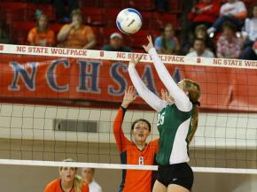 Erin Quinn set! NCHSAA Girls 3A Championship Cardinal Gibbons wins 3 - 0 over Jesse Carson HS. Photo By CHRIS BAIRD