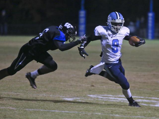Cleveland's Donqua Williams (8) gets around end to put Cleveland on the board first. Wilson Hunt High defeated Cleveland High 33-28 to advance in the NCHSAA 3AA playoffs played at Hunt High School, November 16, 2012.