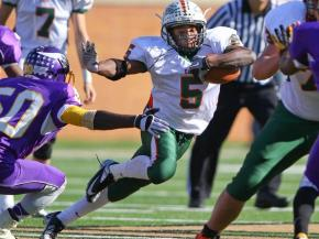 Marquise Pharr for East Lincoln. East Lincoln takes title over Tarboro with 24 to 20 victory. NCHSAA 2 A Football Championship Game Winston-Salem, NC 12.1.12. Photo by CHRIS BAIRD