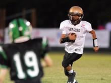 A Knightdale Pop Warner player runs the ball against Cary Pop Warner on Saturday, Oct. 5, 2013.