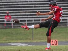 Middle Creek's Michael Rubino punts the ball at the HighSchoolOT Jamboree.