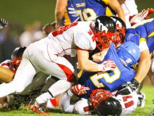 Garner's #2 Nyheim Miller-hines is tackled as Garner defeats Middle Creek 21 to 16 Friday night August 23, 2013. (Photo by Jack Tarr)