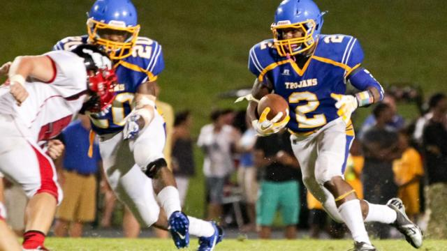 Garner's #2 Nyheim Miller-hines runs the ball as Garner defeats Middle Creek 21 to 16 Friday night August 23, 2013. (Photo by Jack Tarr)