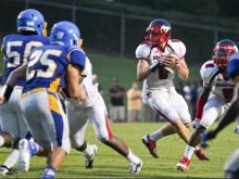 Middle Creek's #9 Brant Grisel drops back top pass as Garner defeats Middle Creek 21 to 16 Friday night August 23, 2013. (Photo by Jack Tarr)