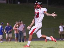 Middle Creek's #33 Michael Rubino punts the ball as Garner defeats Middle Creek 21 to 16 Friday night August 23, 2013. (Photo by Jack Tarr)