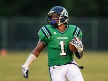 Leesville Road's Malcolm Hitchcock scores a touchdown against Apex.