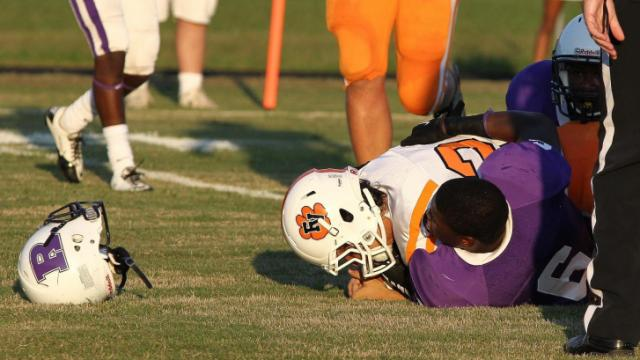 Hey that's my helmet! Fuquay-Varina visits Riverside High School in Durham. Fuquay-Varina takes the victory in a close match-up 22-20. Photo by CHRIS BAIRD