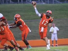 #12 Garrett Cloer passed for 100 yards and a touchdown in Orange High School's 35-0 victory against Graham High School on Friday, Sept. 13 (photo by Will Okun)