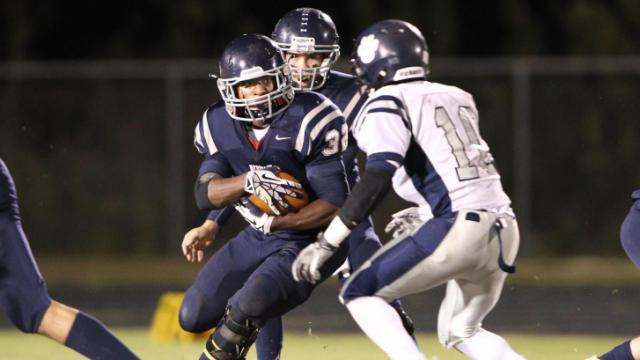 Matt Baker (32) for Heritage. Millbrook spoils Heritage home coming with a victory of 21 to 16. Photo by CHRIS BAIRD
