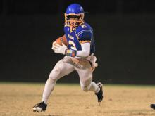 Garner's #2 Nyheim Hines runs with the ball as Garner crushes Holly Springs 63 to 21 Friday night November 15, 2013. (Photo by Jack Tarr)