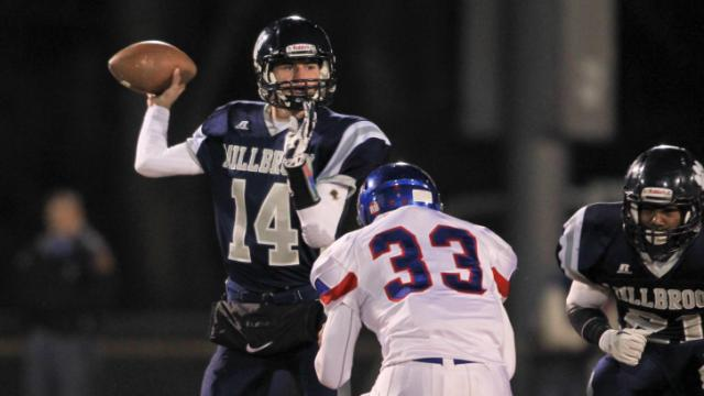 Millbrook's #14 Reid Herring passes the ball. Wake Forest gets by Millbrook in 27 to 24 in OT on Friday night November 29, 2013 in round three of the NCHSAA Football playoffs. (Photo by Jack Tarr)