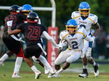 Nyheim Miller-hines #2.  Garner travels to Middle Creek for the 2014 season opener.   Middle Creek holds on to win 28 to 21.  (Photo by:  Suzie Wolf)