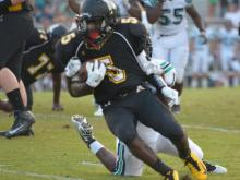Isaiah Totten (#5) of Apex High School runs with the ball.  Apex High School defeats Leesville Road 44 to 14 at Apex High School on Thursday, August 28, 2014. (Photo By: Beth Jewell)
