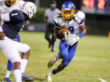 Dudley's Trae Meadows (9) interception return during Dudley High Schools defeat of Hillside High School 12-9 on Friday September 12,  2014, Durham NC.  (Photo: Karl Fisher / WRAL contributor)