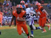 Football: Person vs. Orange (Aug. 21, 2015)