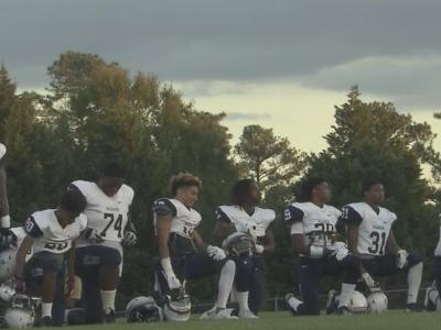 Hillside football players kneel during national anthem