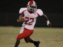 Jeriko Styles (22) with the ball for Sanderson. Friday night football at Leesville Rd High School as they host Sanderson. Homecoming ended well as Leesville defeats Sanderson by 17 to 28. Photo by CHRIS BAIRD