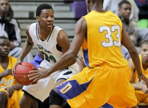 Leesville Road's #24 Reggie Jones looks to pass the ball at the HighSchoolOT.com  Holiday Invitational Tournament December 26, 2012. (Photo by Jack Tarr)