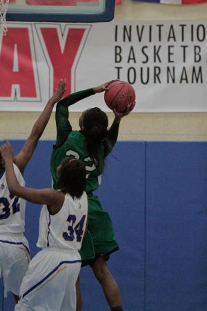 Myers Park's India Timpton (22) goes up for the shot as East Wake's S. Morrison tries to block in the HighSchoolOT.com Holiday Invitational Wednesday night at Cary Academy (photo by Wes Hight).